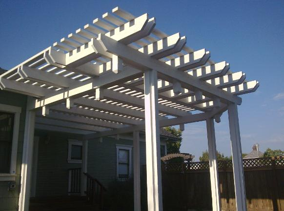 Backyard home remodel side view of patio cover (rafter tails match house)